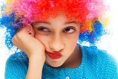 Young girl with party wig stock photos