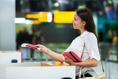 Young girl with passports and boarding passes at Stock Photos