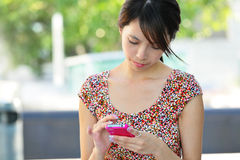 Young girl with pda outdoor Stock Photography