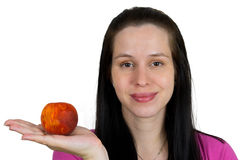 Young girl with peach. Isolated on white Royalty Free Stock Photo
