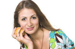The young girl with a peach Royalty Free Stock Photos