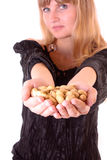 Young girl with peanuts in hands Royalty Free Stock Image