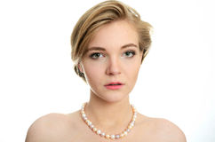 Young girl with pearls Stock Photography