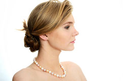 Young girl with pearls Royalty Free Stock Photos