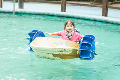 Young girl in a pedal boat stock photos
