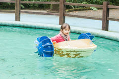 Young girl in a pedal boat stock photo