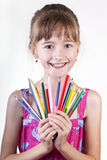 Young girl with pencils Royalty Free Stock Images