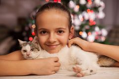 Young girl with the perfect christmas gift - a rescued kitten Stock Photo