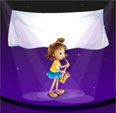 Young girl performing at stage with empty banner Royalty Free Stock Photos