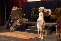 Young girl performing in theater play. Young actress in mouse costume on stage Stock Image