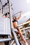 A young girl performing weight lifting in the Gym Royalty Free Stock Images
