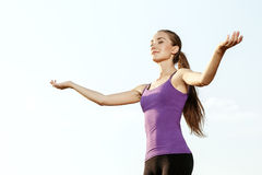 Young girl performing yoga outdoor. Young girl in workout gear performing yoga outdoor Stock Images