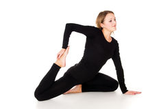 Young girl performs sport exercises Stock Photos