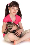 Young girl with pet cat. Young girl sat on white studio background with pet cat Stock Photography