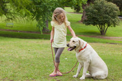 Young girl with pet dog at park Royalty Free Stock Image