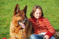 A young girl petting her dog Royalty Free Stock Images
