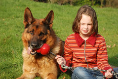 A young girl petting her dog Stock Images