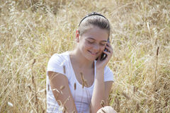 A young girl on the phone Stock Photos