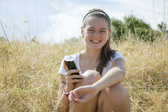 A young girl on the phone Stock Images
