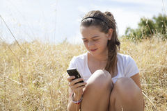 A young girl on the phone Stock Photography