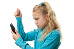 Young girl on the phone is angry Royalty Free Stock Photos
