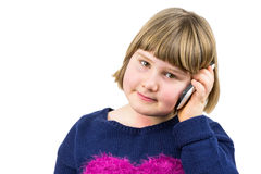 Young girl phoning with mobile telephone Royalty Free Stock Image