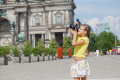 Young girl with photo camera Stock Photos