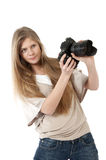 Young girl with photo camera Stock Images