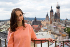 Young girl photographed on a background of old Krakow. Royalty Free Stock Photo