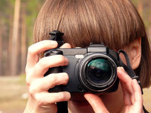 Young girl photographer. Stock Photos