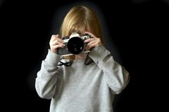 Young Girl Photographer with Old Camera Stock Photography