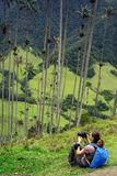 Young girl photographer taking pictures of Cocora valley. The Cocora valley - Valle de Cocora in spanish - is a valley in the department of Quindío in the stock photos