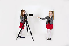Young girl photographer. Two young girls takin a photo using digital camera Stock Photos