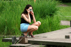 The young girl photographes. The nature Stock Photography