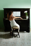 Young girl and piano at home Royalty Free Stock Photos