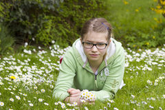 Young girl picking daisies Stock Photo
