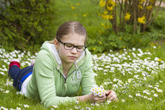 Young girl picking daisies Royalty Free Stock Image