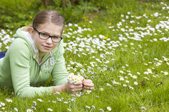 Young girl picking daisies Stock Image
