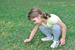 Young girl picking a flower Stock Photos