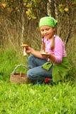 Young girl picking mushrooms Stock Photos