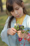 Young Girl Picking Wildflowers Royalty Free Stock Photos