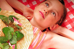 Young girl at picnic Stock Images