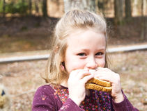 Young Girl on a Picnic. A young girl outside eating a picnic lunch Stock Photo