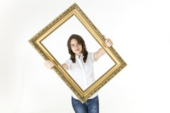 Young girl with picture frame in front of her Stock Photo