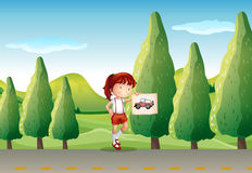 A young girl with a picture of a vehicle Royalty Free Stock Photos