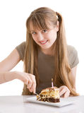 The young girl with a pie Stock Images