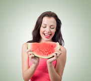 Young girl with piece of watermelon Stock Photos
