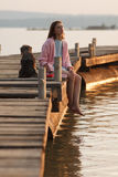 Young girl on pier Royalty Free Stock Photo