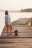 Young girl on pier Royalty Free Stock Image