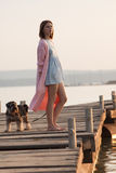 Young girl on pier Stock Photo